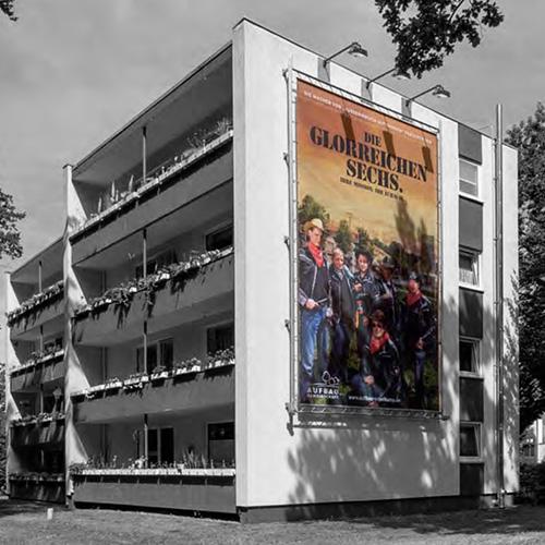 """Aufbaugemeinschaft Espelkamp, Fassadenposter """"Die glorreichen Sechs"""""""